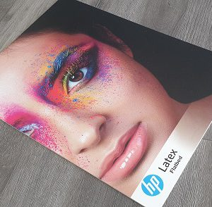 Foam PVC board displaying an image of a woman with bright makeup