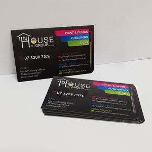 A stack of InHouse Print business cards.